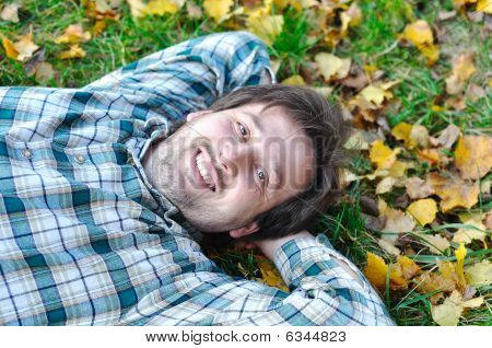 Happy Positive Young Man With His Kid On Fall Ground