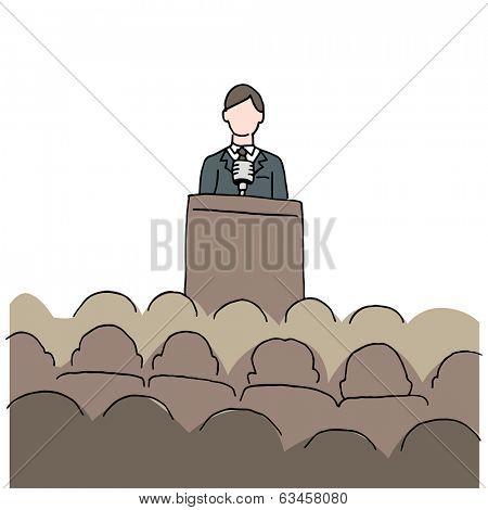 An image of a man making a public speech.