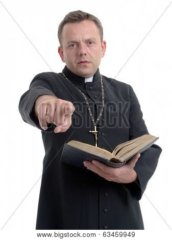 Catholic priest preaching while holding a Bible, against a white background. poster