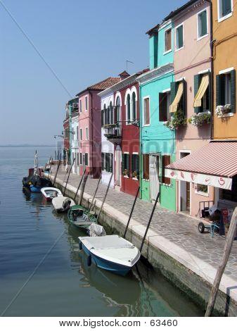 Boats Moored In Burano, Venice, Italy.