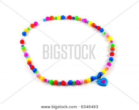 Plastic Children's Multi-colored Beads Isolated On White