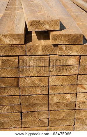 Stacks of wood planks in lumber yard