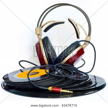 headphones arranged over some old 45 rpm records