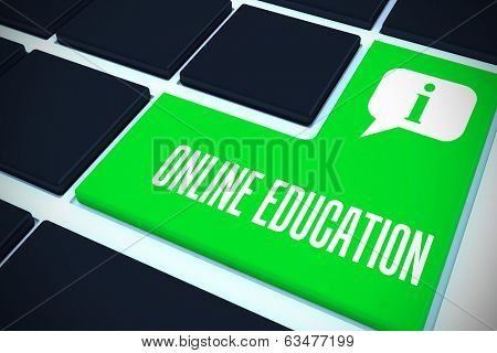 The word online education against green key on black keyboard