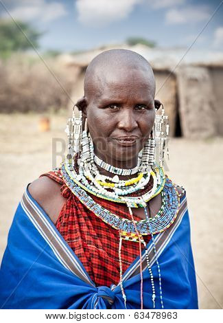 TANZANIA, AFRICA-FEBRUARY 9, 2014: Masai woman with traditional ornaments, review of daily life of local people on February 9, 2014. Tanzania.