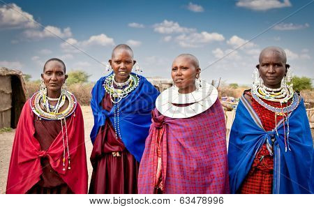 TANZANIA, AFRICA-FEBRUARY 9, 2014: Masai women with traditional  ornaments, review of daily life of local people on February 9, 2014. Tanzania.