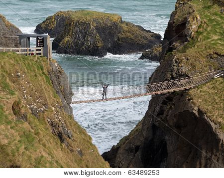 Young Woman On Rope Bridge Ireland