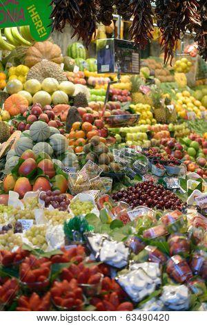 BARCELONA, SPAIN - JANUARY 9, 2013: Abundance of fruits on the farmer's market Mercat de Sant Josep de la Boqueria. It's the most popular of the many food markets in Barcelona