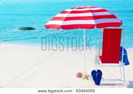 Beach Umbrella And Chair By The Ocean