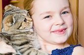 Image of beautiful girl with grey kitty poster