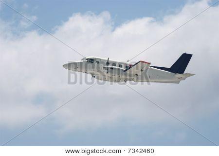 Small Regional Propeller Airplane Is Landing