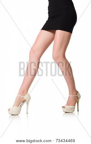 Woman legs with shoes isolated on the white