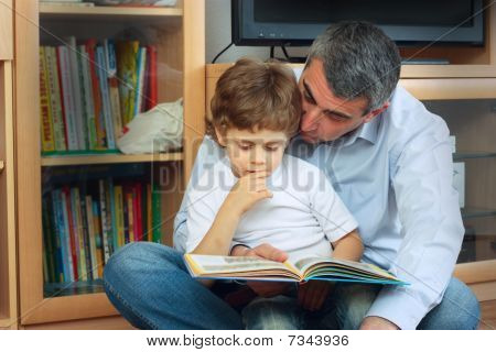 Man And Little Boy Reading Book