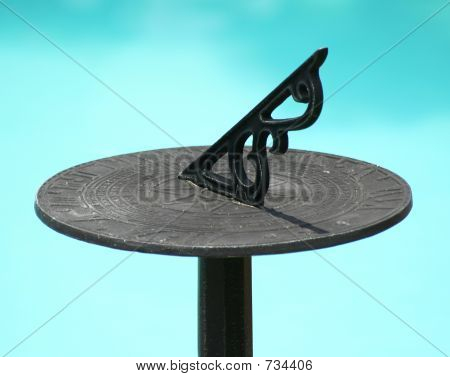 Sundial with pool in background