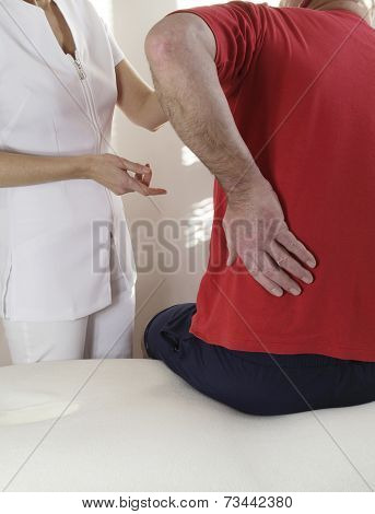 Consultation with a sports massage therapist