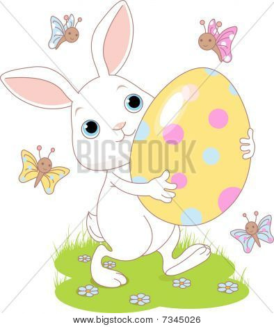 Easter bunny carrying egg
