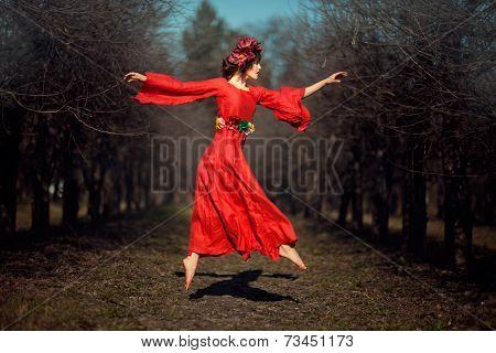 Girl In Red Dress Soars.