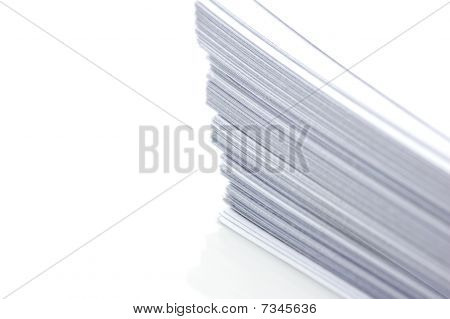 Stacks of white plain paper on white background poster