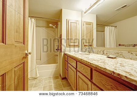 Bathroom Interior With In Soft Ivory Tones With Wooden Cabinet