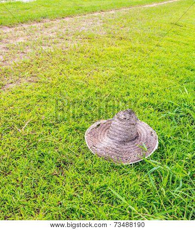 Old Farmer's Hat On Grass Field
