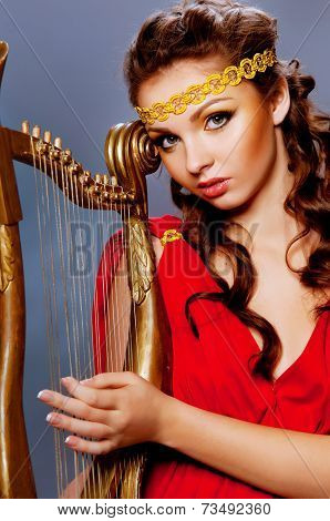 Beautiful Young Girl Playing The Harp