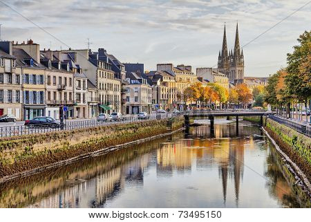 Embankment of river Odet and cathedral of Saint-Corentin reflecting in river Quimper Brittany France poster