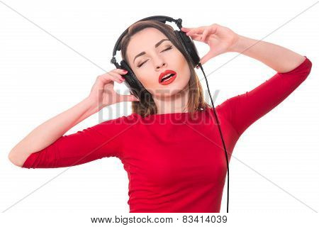 Pretty Girl With Red Lipstick And Red Clothes Listening To The Music With Closed Eyes Touching Big H
