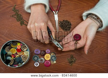woman making craft jewellery