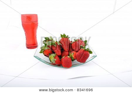 Strawberries In Glass Bowl With Glass Of Water