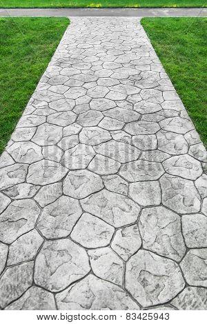 Garden stone walkway with grass Brick Sidewalk poster