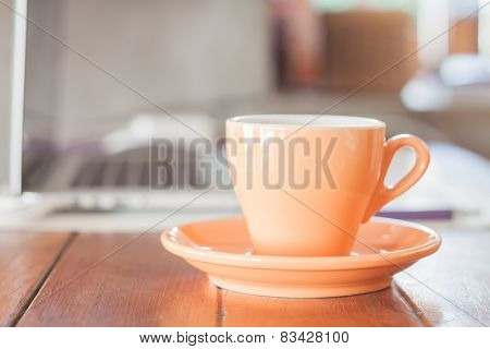 Orange Coffee Cup On Work Station