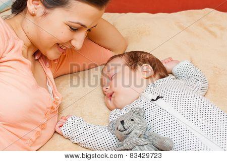 Mother Watching Her Baby Sleep