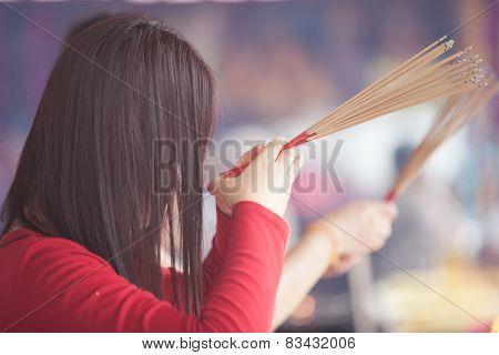 Woman prays at Quan Yin Temple