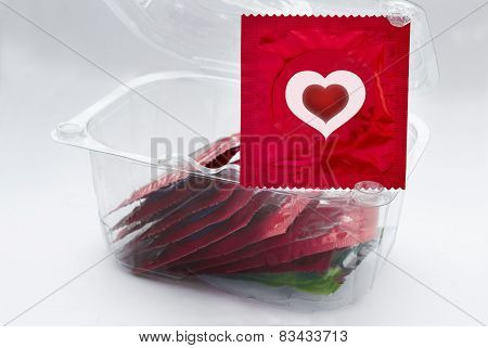 Red Condom With Heart And A Transparent Box With A Lot Of Condoms