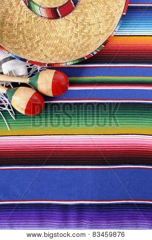 Mexican background with sombrero straw hat maracas and traditional serape blanket or rug. Space for copy. poster