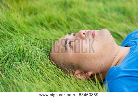 Fat Man Lying On The Green Grass With A Stress Thoughts In Mind