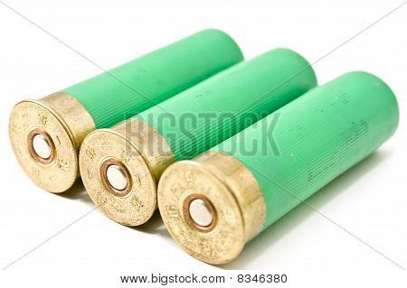 Three Shotgun Cartridges