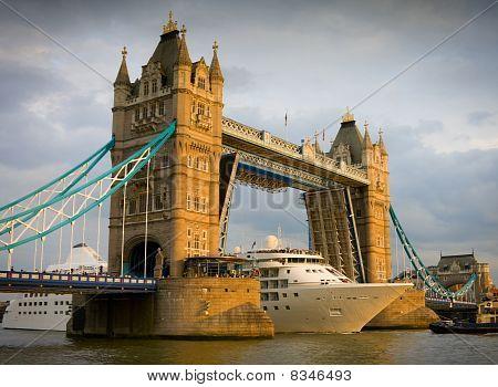 Cruise Ship Passing Tower Bridge At Sunset