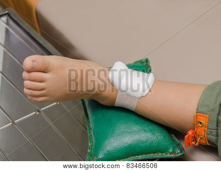 Child Boy With Bandage On Leg And Lying Down Hospital Bed