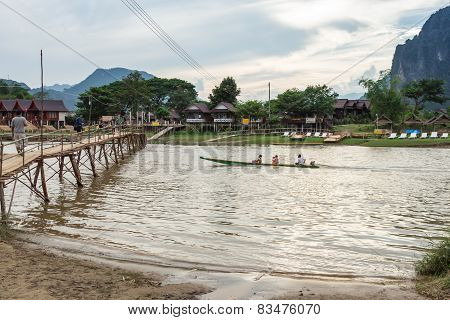 Vang Vieng, Lao P.d.r. - October 24 : Unidentified Tourists Are Rowing Kayak Boats In Song River On
