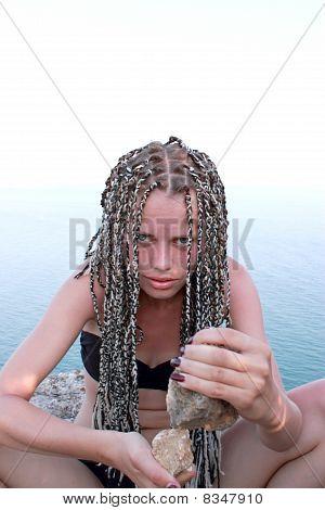 Primitive Girl With Stones In Hands