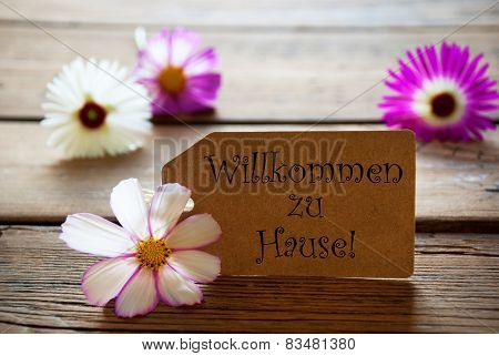 Label With German Text Willkommen Zu Hause With Cosmea Blossoms