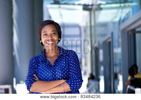 Happy Young Business Woman Standing Outside Office Building