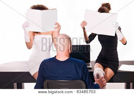 Sexy Two Women At Office With Magazines And A Man With A Laptop