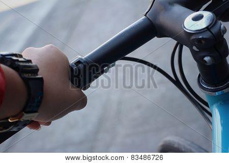 Wrings Hands On The Handlebars Of The Bike.