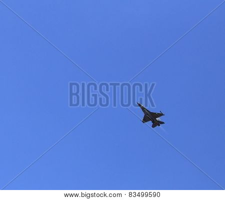 F16 Falcon Fighter Jet Flying On Blue Sky