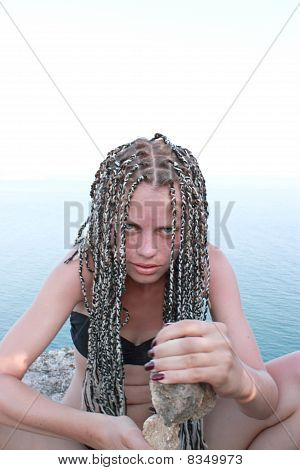 Girl With Stones In Hands