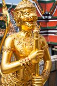 Golden Angle at Wat Phra Kaeo Temple of the Emerald Buddha and the home of the Thai King. Wat Phra Kaeo is one of Bangkok's most famous tourist sites and it was built in 1782 at Bangkok Thailand. poster