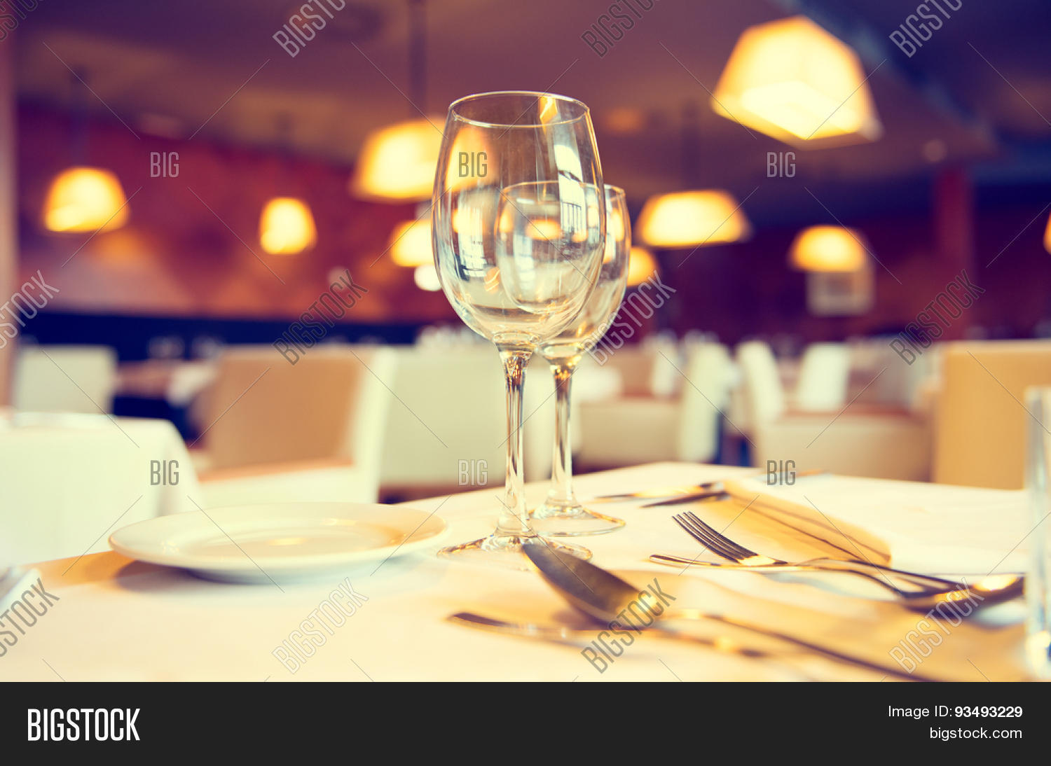 dinner table background. Served Dinner Table In A Restaurant. Restaurant Interior. Cozy Setting. Defocused Background R