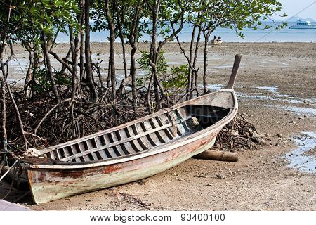 Abandonned Long Tail Boat  In Railay Beach Thailand